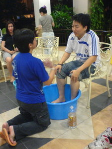 J-son getting his feet washed by Choon Ean.